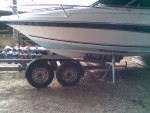 The boat is jacked up and the trailer is gently winched backwards underneath  - click to enlarge