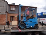 A 2.5 ton fork lift being transported on our special fork lift trailer which has three ramps. - click to enlarge